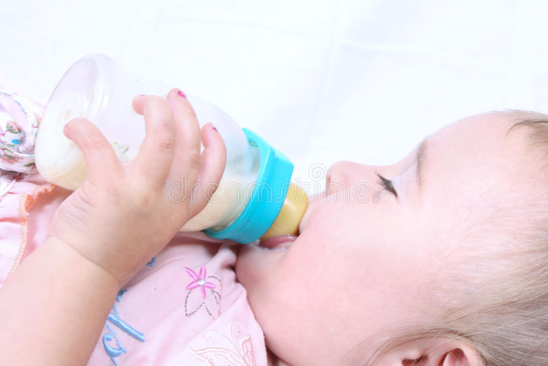 Baby eating royalty free stock image