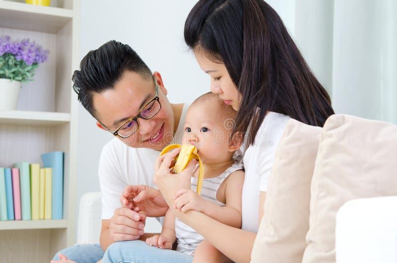 Baby eating banana royalty free stock image