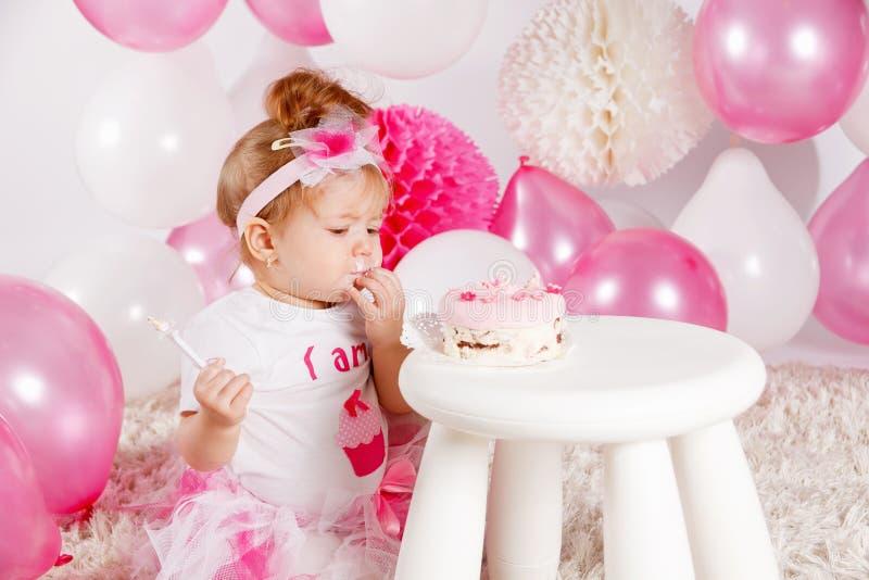 Baby eating the birthday cake royalty free stock photos