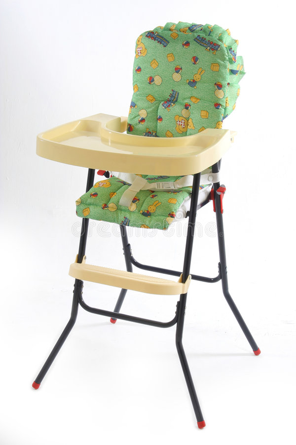 Baby eating chair stock photography