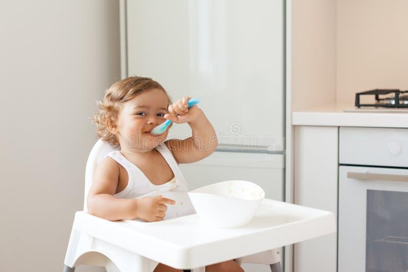 Baby eating fruit stock image