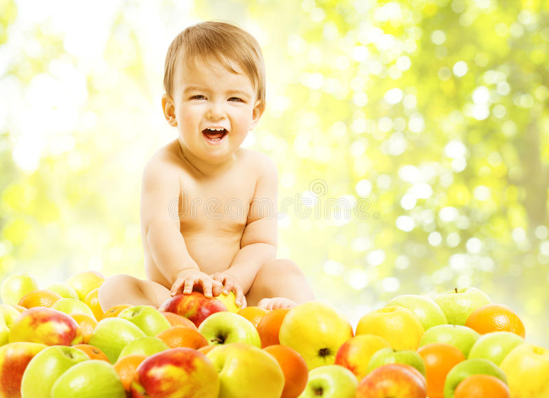 Baby Eating Fruits, Children Food Healthy Diet, Kid Boy Apples. Baby Eating Fruits, Children Food Healthy Diet, Active Kid Boy in Apples royalty free stock photos