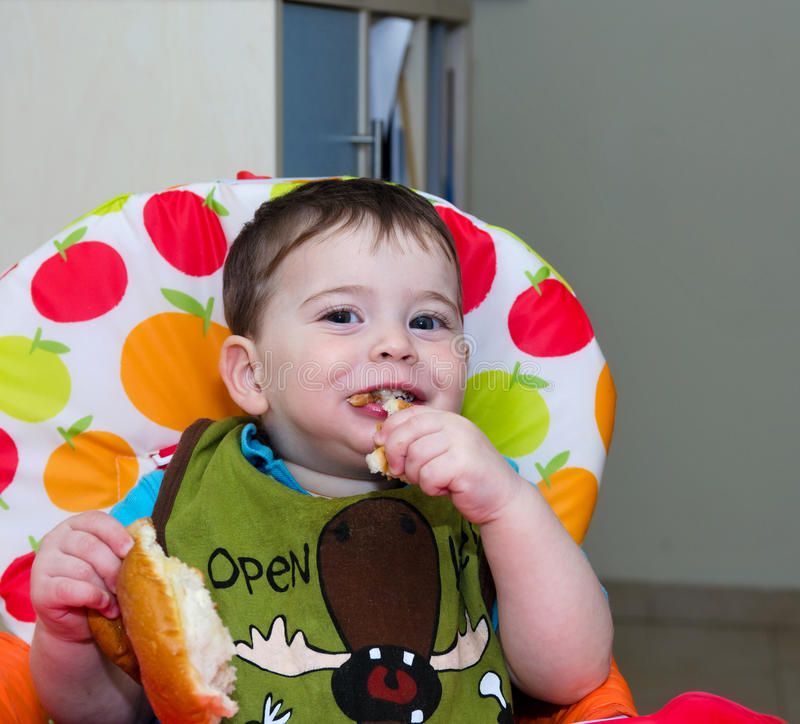 Baby Eating Hanukkah Donut Royalty Free Stock Image