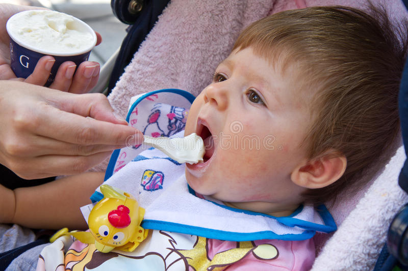 Download Baby eating ice cream stock image. Image of dessert, blond - 26142995