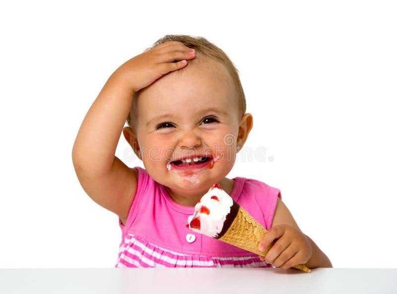 Baby eating ice cream stock photo