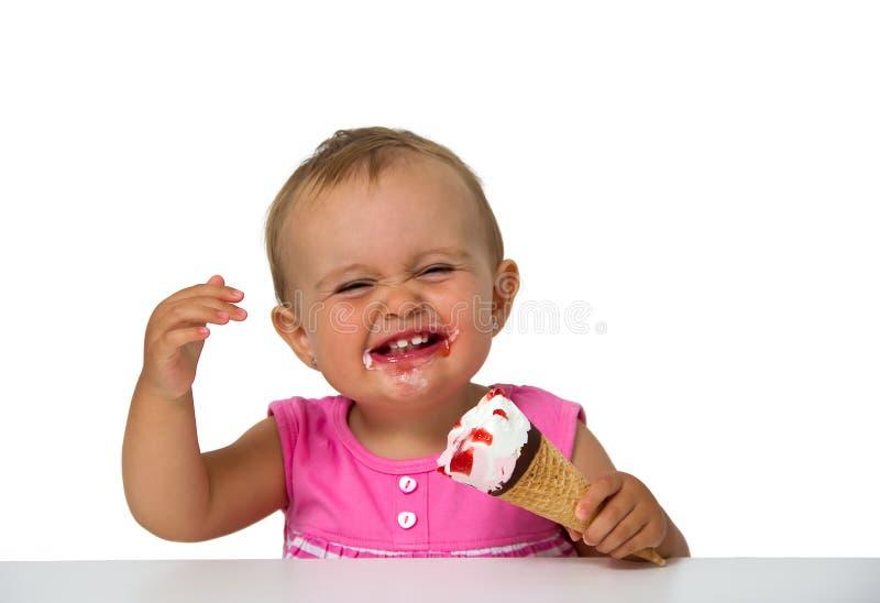 Baby eating ice cream stock image