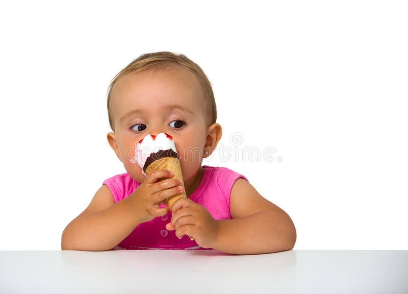 Baby eating ice cream royalty free stock photos