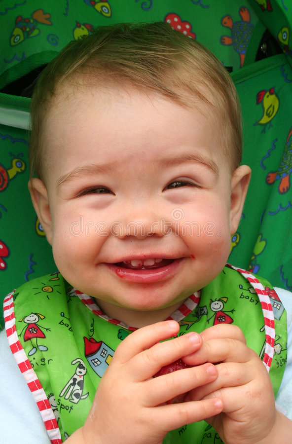 Baby Eating Strawberry Stock Image