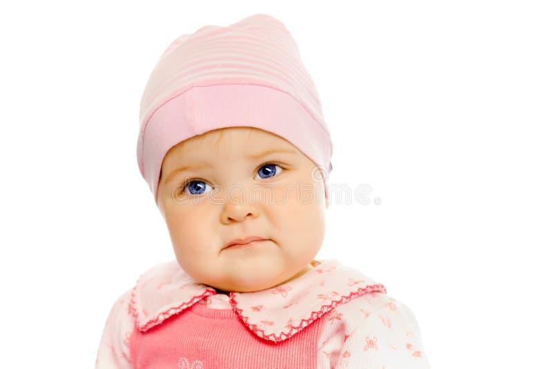 Baby in einem rosa Kleid und in einem Hut Porträt studio Getrennt stockbild