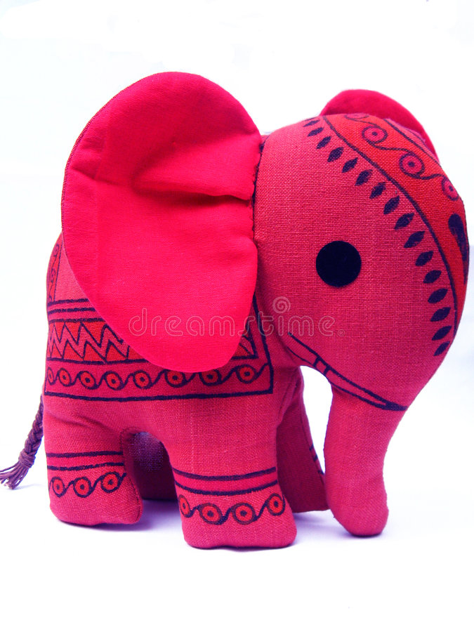 Baby Elephant Toy. A cute bright pink colored baby elephant soft toy, with a traditional Indian design on it stock photo