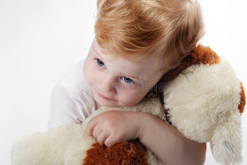 Baby embrace toy dog. Happy baby embrace toy dog stock photography