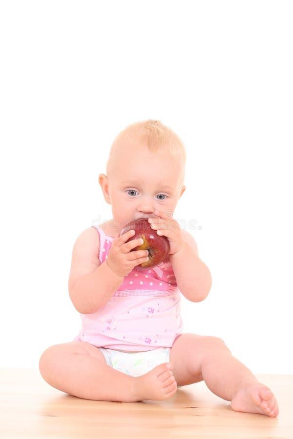 Baby en appel royalty-vrije stock foto's