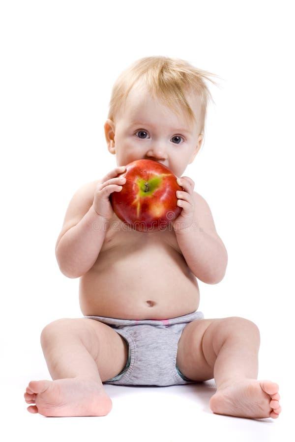 Baby en appel royalty-vrije stock fotografie