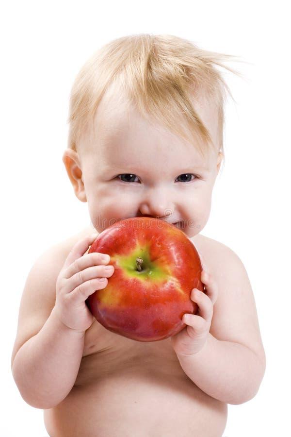 Baby en appel royalty-vrije stock afbeeldingen