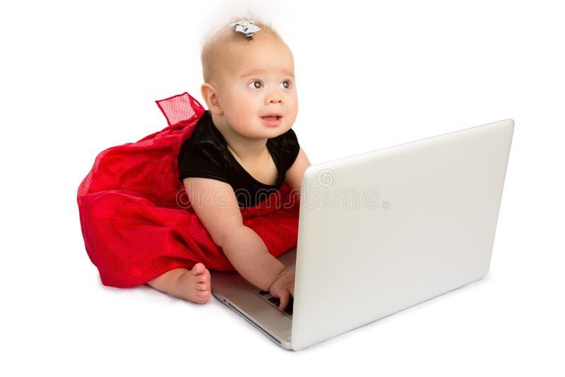 Baby en laptop stock fotografie