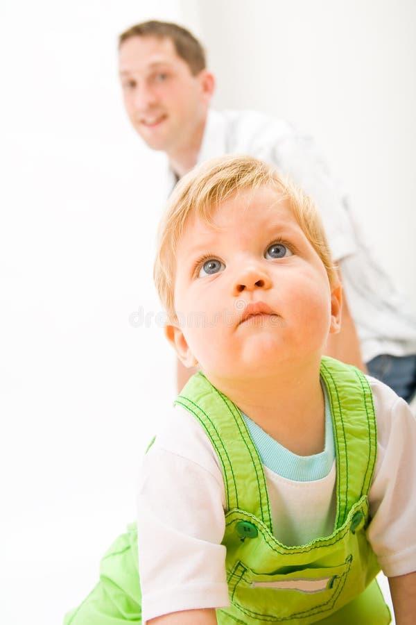 Baby en vader stock afbeelding