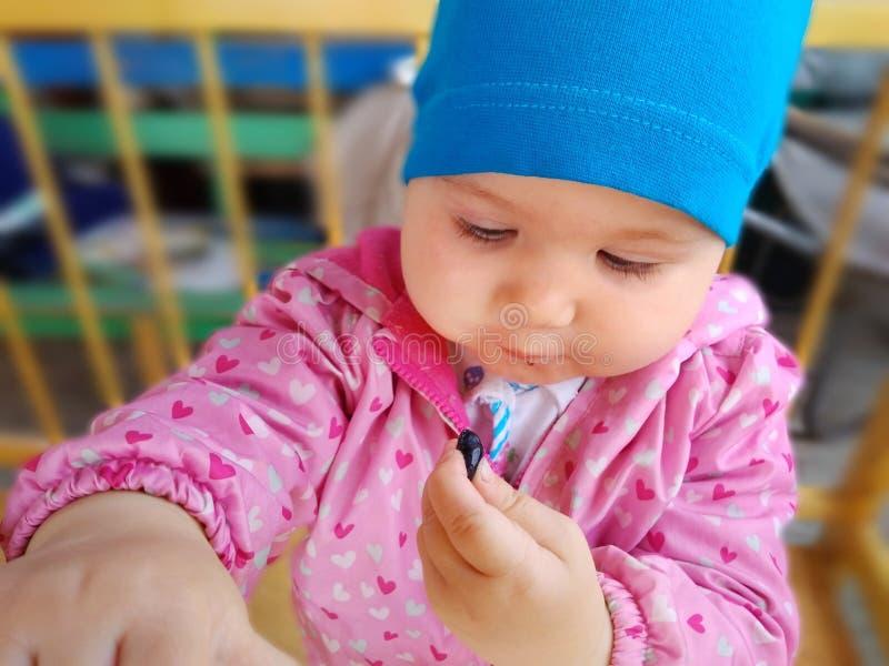 Baby eats honeysuckle royalty free stock photography