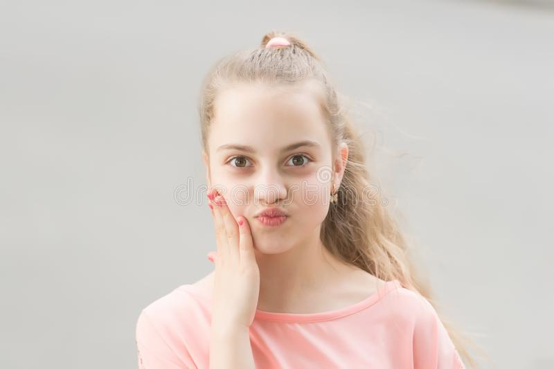 Baby face. Adorable baby face look. Little child with cute face. Small girl with healthy young face skin and long blond royalty free stock images