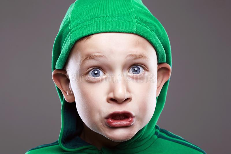 Baby face. Funny boy in Hood royalty free stock image