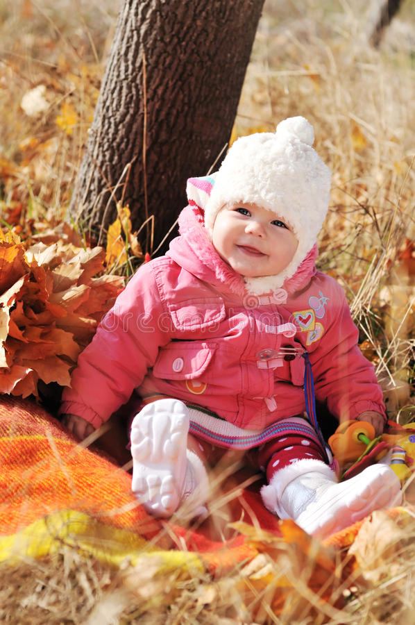 Baby in fall time royalty free stock image