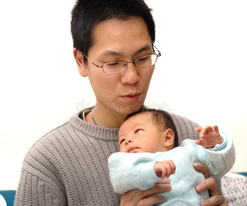 Baby and father stock images