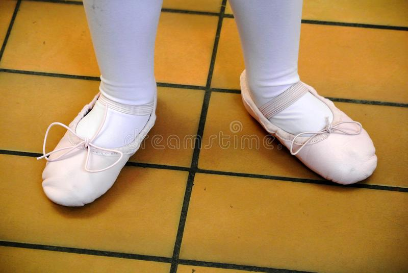 Feet of a dancer with shoes royalty free stock image