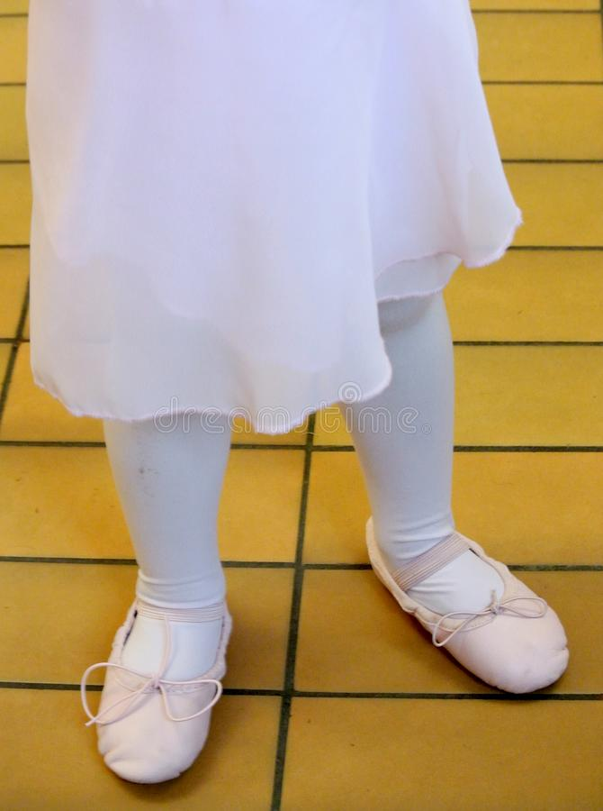 Feet of a dancer with shoes stock photos