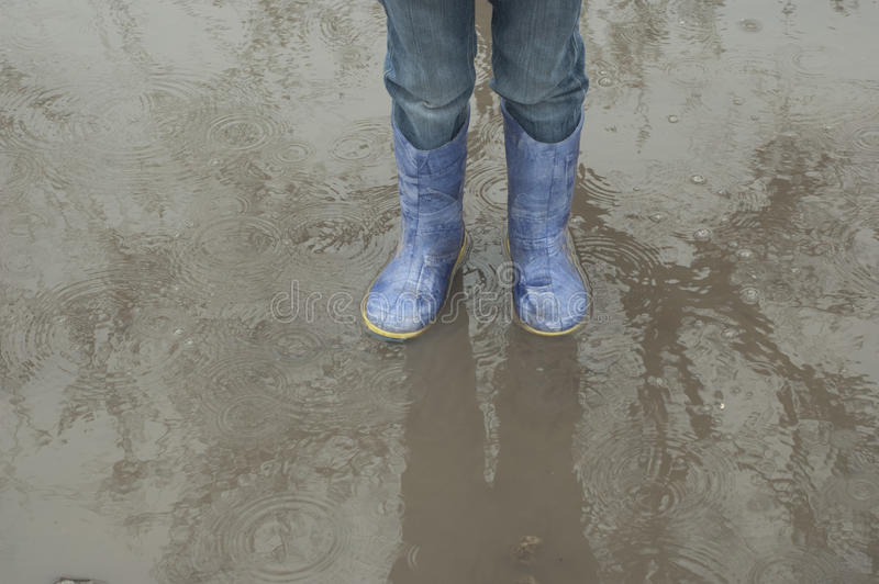 Baby feet in a puddle stock images