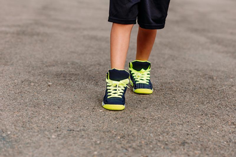 Baby feet in sneakers. Close outdoors royalty free stock photos