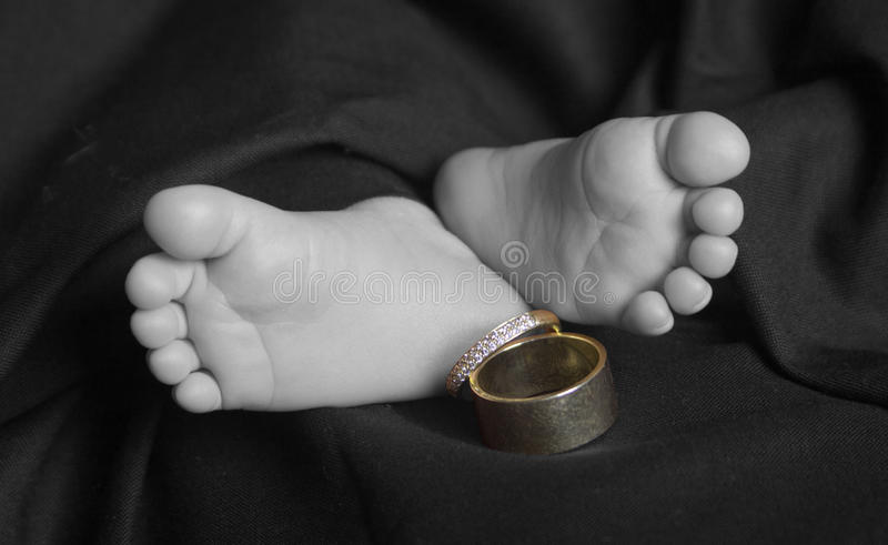 Download Baby Feet With Wedding Rings Selective Color Stock Photo - Image: 22093150