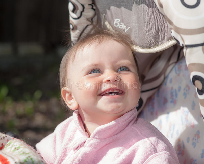 Baby with the first teeth royalty free stock images
