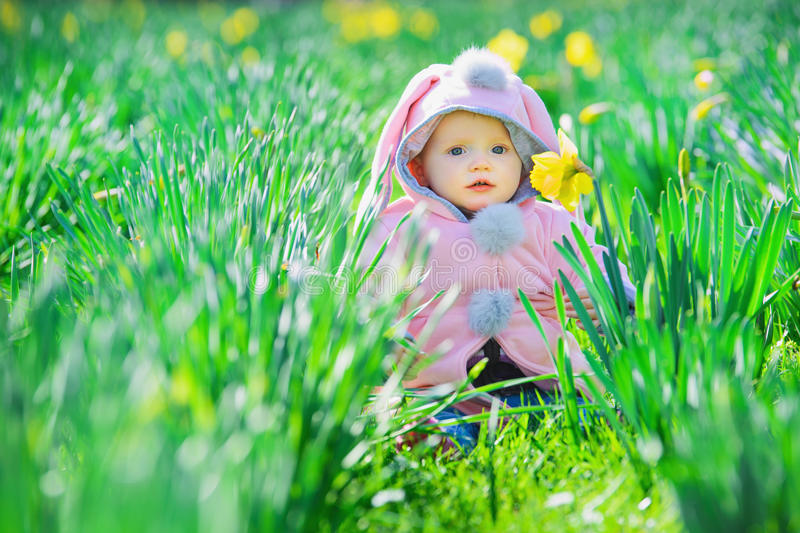 Baby and flowers stock image
