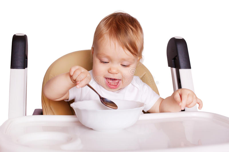 Baby food. Baby eating by himself royalty free stock photos