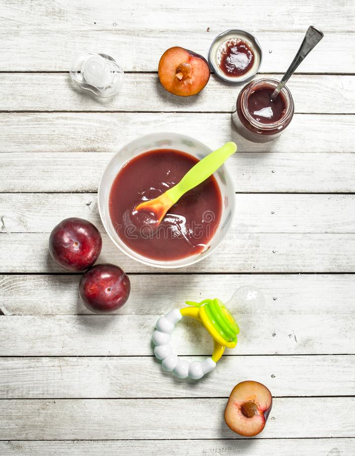 Baby food. Baby puree from fresh plum. royalty free stock photography
