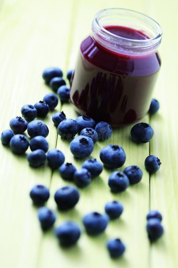 Baby food - blueberries stock photo