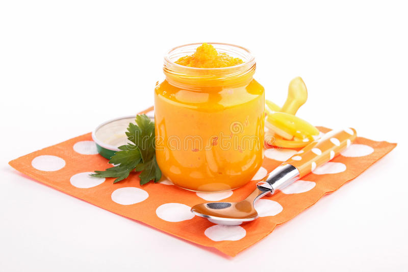 Baby food,carrot puree. On white stock photos