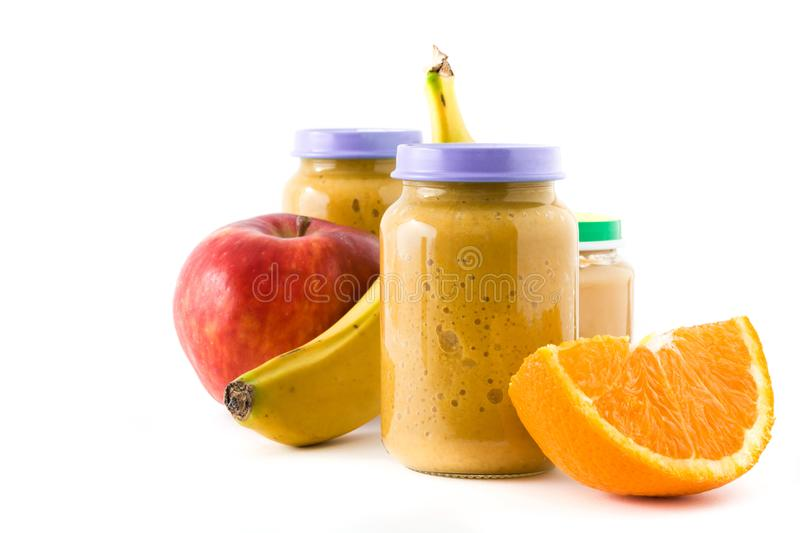 Baby food: Jar with fruit puree. On white background.Copyspace stock photo