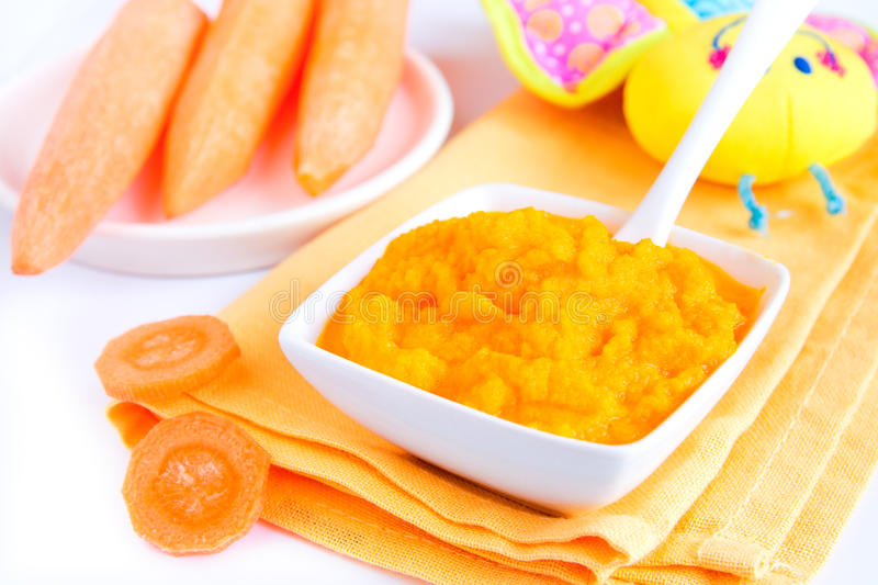 Baby food. (pureed carrot) close up on white table stock photography