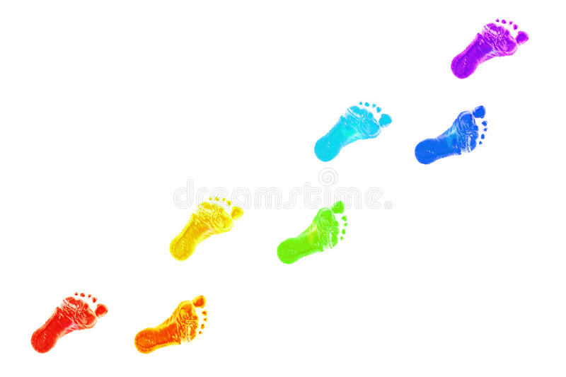 Baby foot prints all colors of the rainbow. stock photos