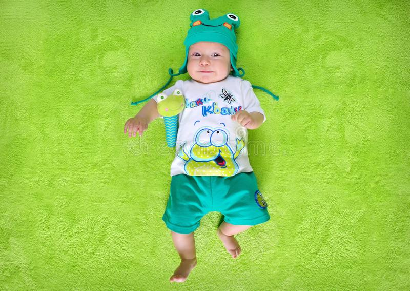 Baby with a frog costume royalty free stock photography