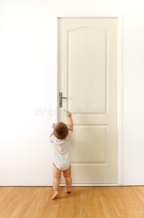 Download Baby in front of door stock photo. Image of unknown, curiousity - 15398896