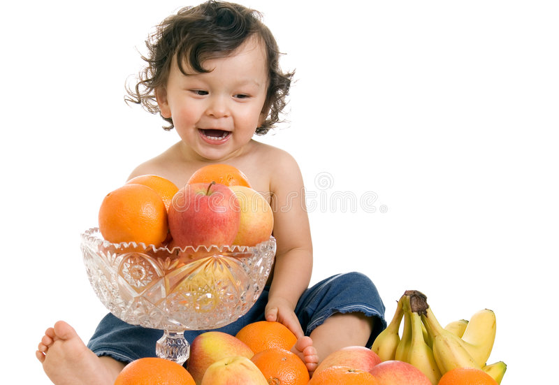 Baby with fruits. stock photography