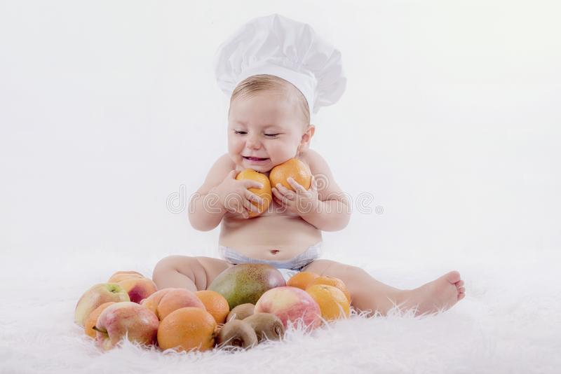 Baby with fruits royalty free stock photos