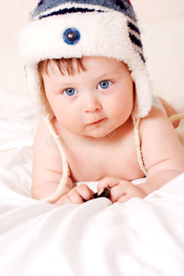 Baby in fur-cap. Face portrait of beautiful baby in fur-cap stock image