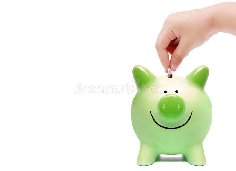 Baby gör grön besparingen royaltyfri bild