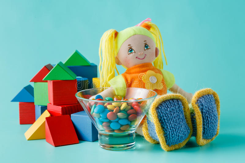 Baby game concept. Baby play concept, cloth doll and wooden bilding blocks for play stock photography