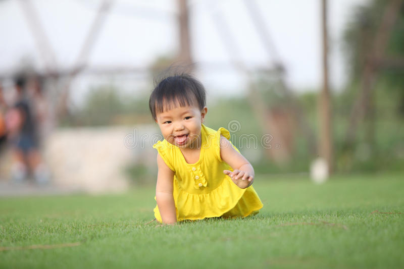 Download Baby Gir Crawl On Lawn In The Park ,facetious Stock Image - Image: 35178333