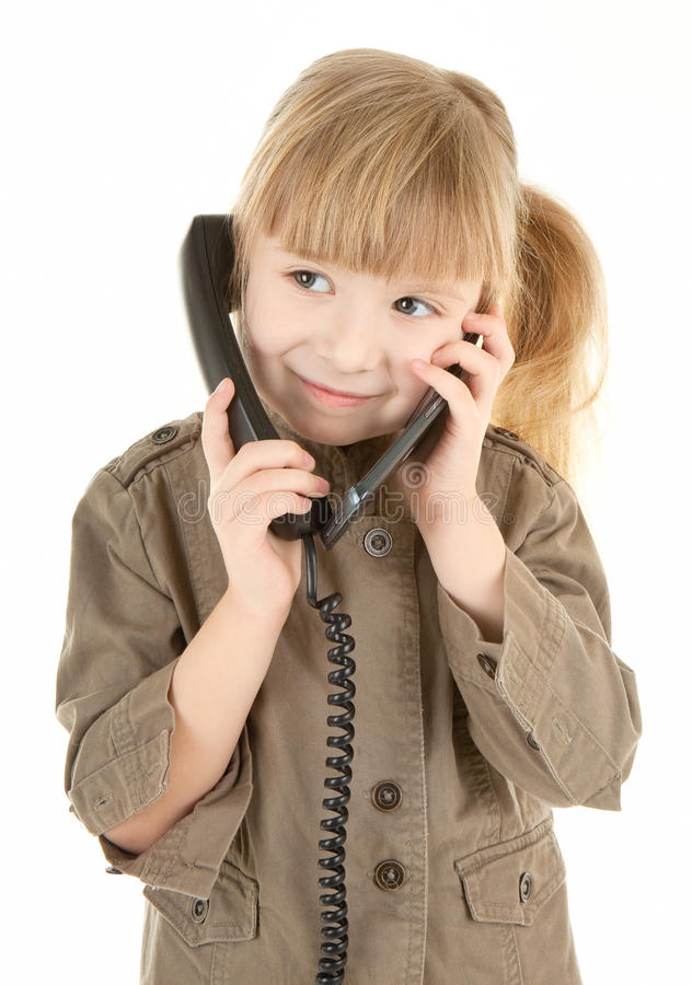 Baby girl. Friendly girl in walking clothing holds phone stock images