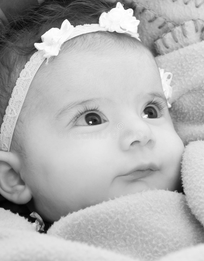 Baby Girl. A baby girl looks up at her mother royalty free stock photo