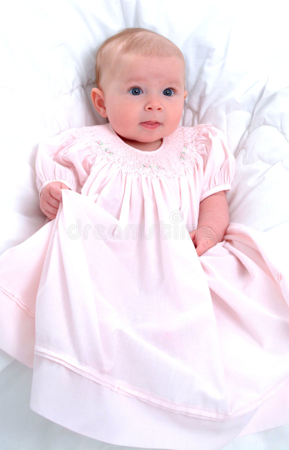 Baby girl. Sitting in front of white background royalty free stock photos